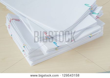 Pile Of Overload Paperwork And Reports With Colorful Paper Clip