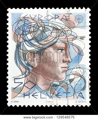 SWITZERLAND - CIRCA 1986 : Cancelled postage stamp printed by Switzerland, that shows Woman.