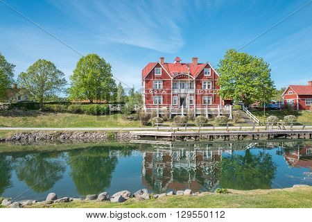 BORENSBERG, SWEDEN - MAY 12, 2016: Gota Canal and Gota Hotel on in Borensberg. The canal contributes to a 390 km long waterway with 58 locks connecting the Swedish west coast with the east coast.
