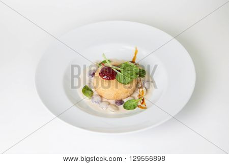 Fried cheese snack on a white plate