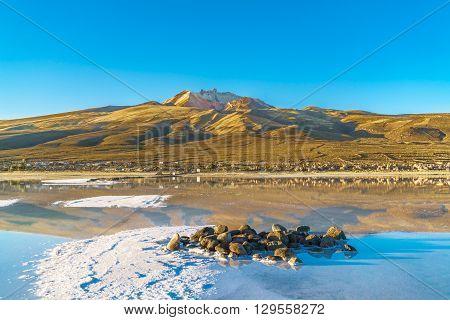 View of dormant volcano in Uyuni Salt Flat in the evening