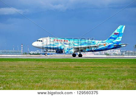 SAINT PETERSBURG RUSSIA - MAY 11 2016. Rossiya Airbus A319 aircraft with FC Zenit livery -registration number VQ-BAS- rides on the runway after landing in Pulkovo International airport