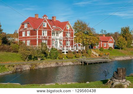 BORENSBERG, SWEDEN - OCTOBER 12, 2010: Gota Canal and Gota Hotel on in Borensberg. The canal contributes to a 390 km long waterway with 58 locks connecting the Swedish west coast with the east coast.