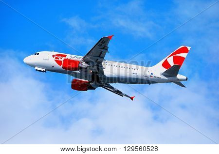 SAINT PETERSBURG RUSSIA - MAY 11 2016. CSA Czech Airlines Airbus A319 airplane-registration number OK-MEK - is flying in the sky after departure from Pulkovo International airport