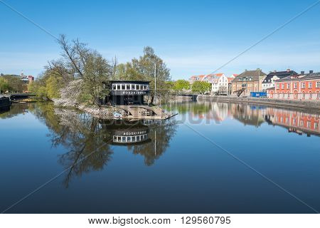 NORRKOPING, SWEDEN - MAY 6, 2016: Motala river and Stromsholmen island during spring in Norrkoping. The river drains Lake Vattern into the Baltic sea at Norrkoping.