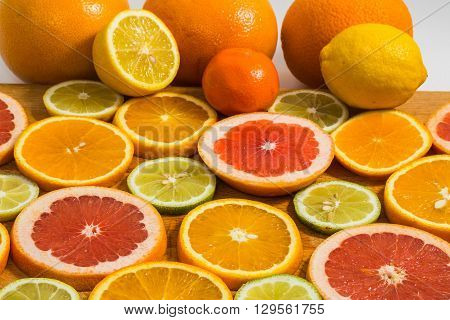 Citrus Fruit Background With Sliced F Oranges Lemons Lime Tangerines And Grapefruit
