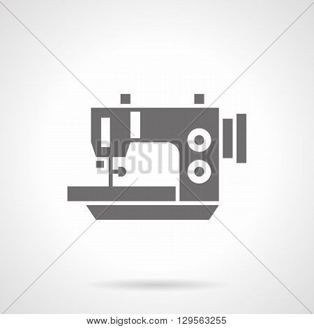 Tailor work tool - electric sewing machine. Professional sewing factories and ateliers. Sale of sewing equipment. Symbolic black glyph style vector icon. Element for web design and mobile.