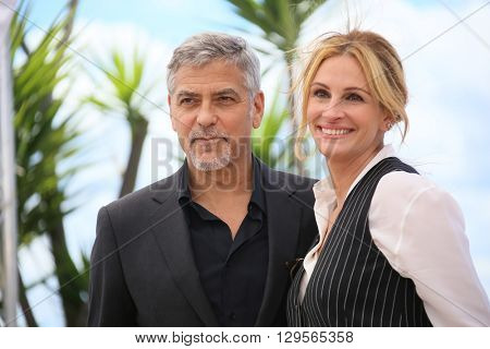 Julia Roberts, George Clooney attend the 'Money Monster' photocall during the 69th annual Cannes Film Festival at the Palais des Festivals on May 12, 2016 in Cannes, France.