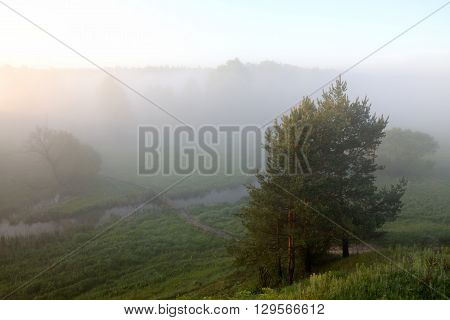 Sunrise and morning mist over the river
