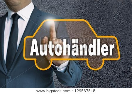 Autohaendler ( In German Car Dealer) Auto Touchscreen Is Operated By Businessman Concept
