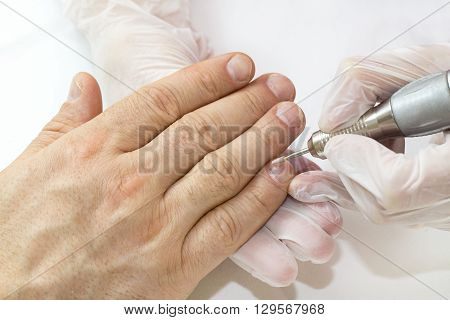 the process of the male manicure in a beauty salon