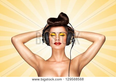 Retro photo of a nude pin-up girl with big vintage music headphones on colorful abstract cartoon style background.