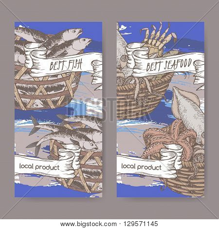 Set of two labels with, color fish and seafood baskets on hand painted blue background. Great for markets, fishing, fish processing, canned fish, seafood product label design.