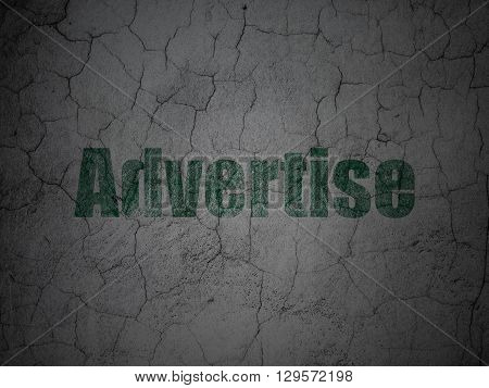 Advertising concept: Green Advertise on grunge textured concrete wall background