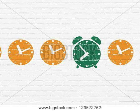 Time concept: row of Painted orange clock icons around green alarm clock icon on White Brick wall background