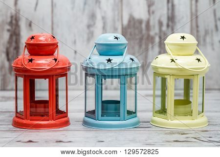 Colorful Candle Holders On White Wooden Background