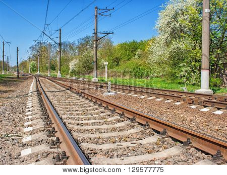 railway receding into the distance on sunny spring day