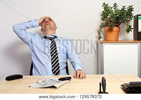 Manager Holds His Head Because Of Bad Share Prices