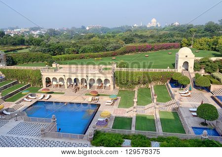 AGRA INDIA - NOVEMBER 11 2015: Taj Mahal seen from the Amervilas Resort and Spa. The resort is part of the Oberoi chain of luxury hotels.