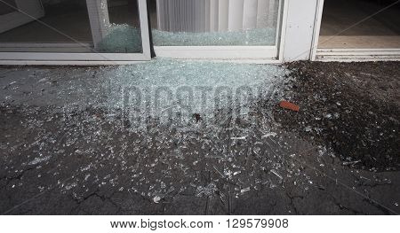 Shattered glass from a sliding door broken during a home invasion