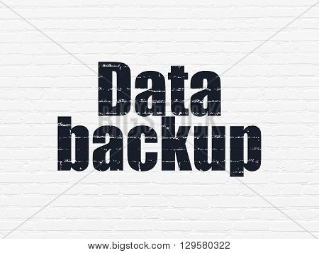 Information concept: Painted black text Data Backup on White Brick wall background