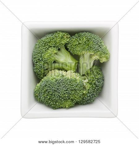Broccoli in a square bowl isolated on white background