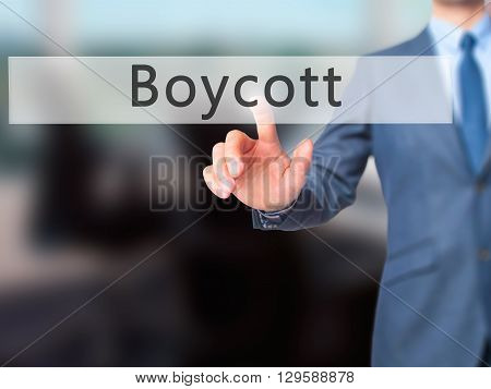 Boycott - Businessman Hand Pressing Button On Touch Screen Interface.