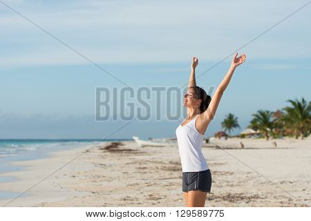Blissful Sporty Woman Enjoying Relax And Tranquility At The Beach