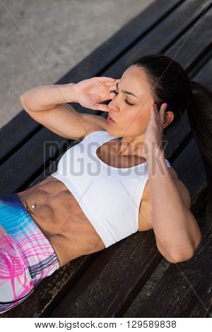 Fitness Woman Doing Crunches Outside