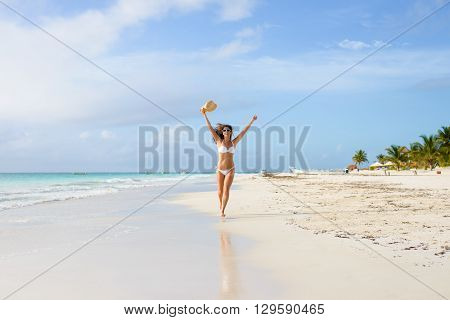 Happy Woman Running And Having Fun On Tropical Beach Vacation