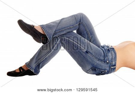A middle age woman lying on the floor in jeans in a closeup image from the side isolated for white background.