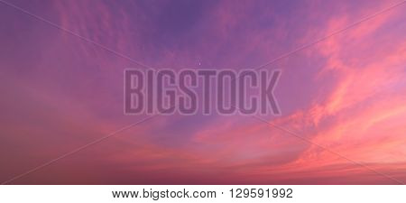Abstract nature background.Moody pink purple clouds sun set sky with long shutter