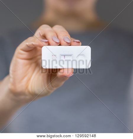 View of woman with negative pregnancy test
