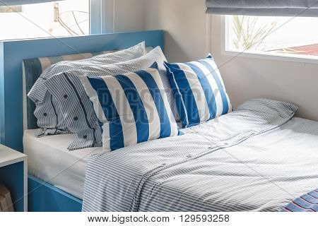 Modern Kid's Bedroom With Blue Bed And Blue Pillows Color Tone