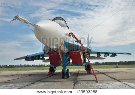Vasilkov Ukraine - June 19 2010: Ukrainian Air Force MiG-29 fighter plane on the airbase preparing for a training flight