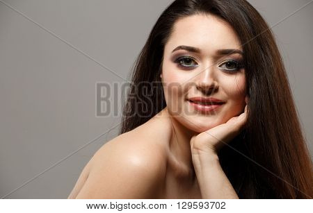 Portrait close up of young beautiful woman in studio