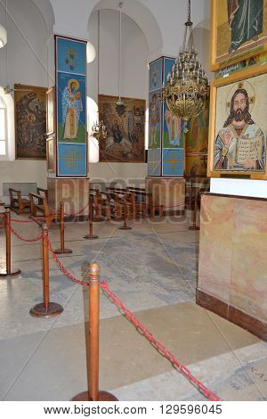 MADABA JORDAN - JULY 22 2015: Saint George Greek Orthodox Church Interior. The Church is also know for the 6th century mosaic map of the region.