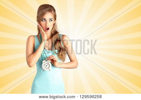 Creative photo of a shocked pin-up girl being late and holding a retro alarm clock on colorful abstract cartoon style background.