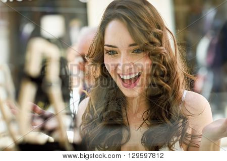 Woman Looking To Showcase Or Shop Window