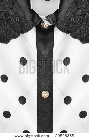 White with black polka dots blouse collar as a background