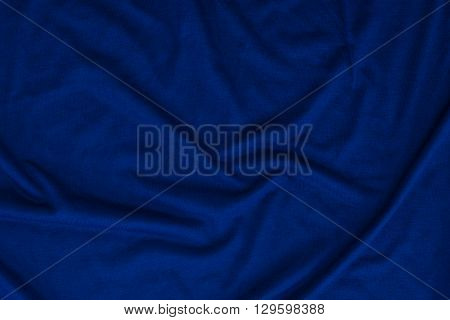 Close up of beautiful wrinkle navy blue color bedsheet fabric texture.