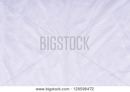 Close up of beautiful wrinkle white color bedsheet fabric texture.