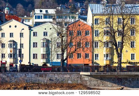 Innsbruck Austria - February 8 2010: The Mariahilf strasse colored houses on the Inn river