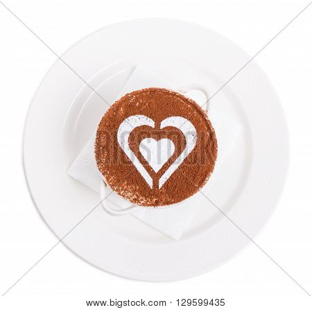 Tiramisu dessert with heart shaped pattern from powdered sugar and garnished with chocolate. Isolated on a white background.
