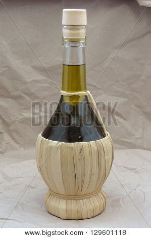 Olive oil in a traditional shaped straw flask