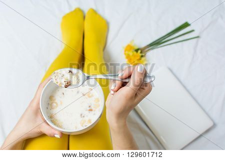 Girl Eating Cereals In Bed