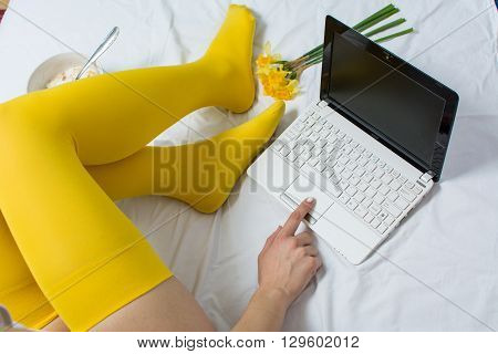 Girl Working And Eating Cereals In Bed
