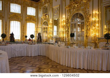 SAINT-PETERSBURG RUSSIA - March 14 2015: Interior of dining room in Catherine's Palace in Tsarskoye Selo (Pushkin) 30 km south of Saint- Petersburg Russia
