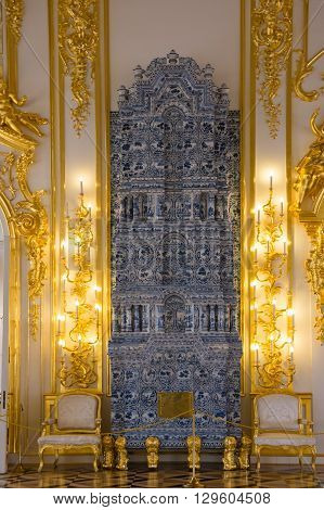 SAINT-PETERSBURG RUSSIA - March 14 2015: Ceramic fireplace in one of the halls in Catherine's Palace in Tsarskoye Selo (Pushkin) 30 km south of Saint- Petersburg Russia