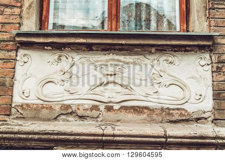 Crazed Antique Balcony with Stucco Moulding on the Old Brick Building,Toned
